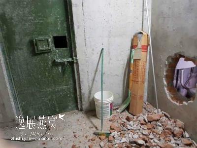 小偷破坏墙壁进入
